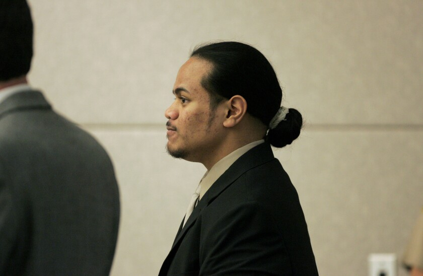 In this November 2008 file photo, Penifoti Taeotui stands in a Vista courtroom to hear the verdict in his case. He was convicted on all charges in the shooting death of Officer Dan Bessant.