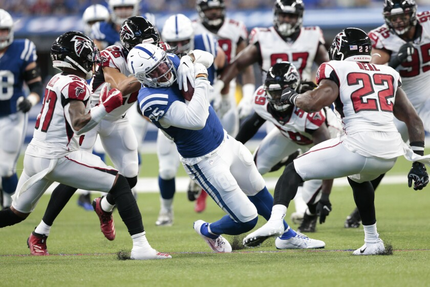 Indianapolis Colts tight end Eric Ebron (85) is tackled by Atlanta Falcons free safety Ricardo Allen (37) and strong safety Keanu Neal (22) during the first half of an NFL football game, Sunday, Sept. 22, 2019, in Indianapolis. (AP Photo/AJ Mast)