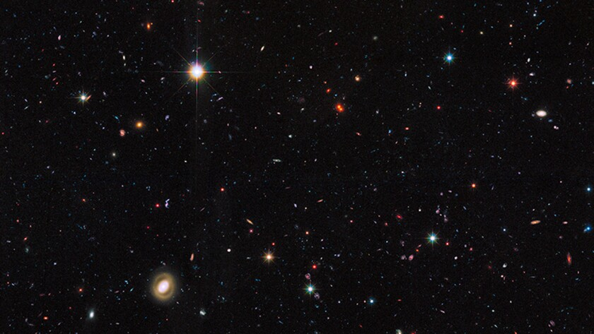 The Hubble Space Telescope has been taking a census of galaxies in the universe. This image includes a portion of a large galaxy census called the Great Observatories Origins Deep Survey, or GOODS.