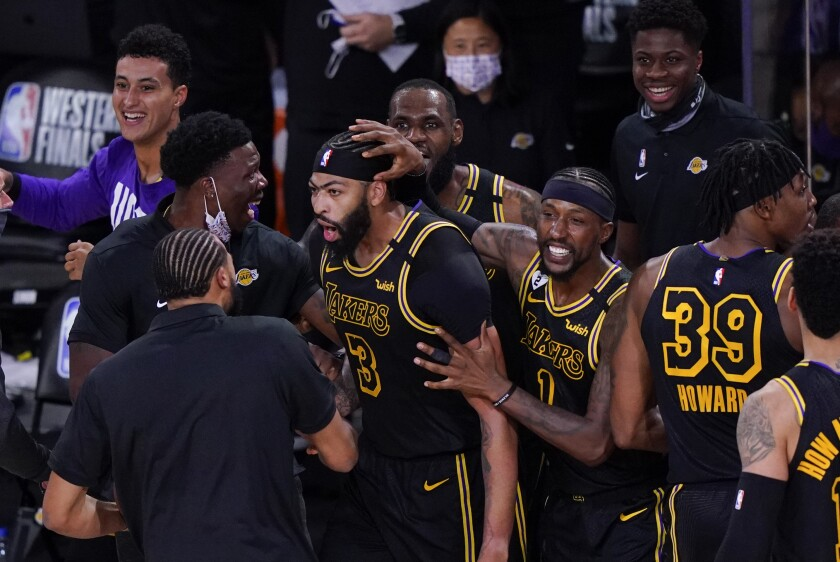 Los Angeles Lakers' Anthony Davis (3) celebrates with teammates after an NBA conference final playoff basketball game.
