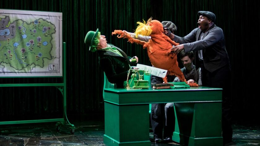 "From left: Steven Epp as the Once-ler, and Meghan Kreidler, Rick Miller and H. Adam Harris (with puppet) as the Lorax, in ""Dr. Seuss's The Lorax,"""