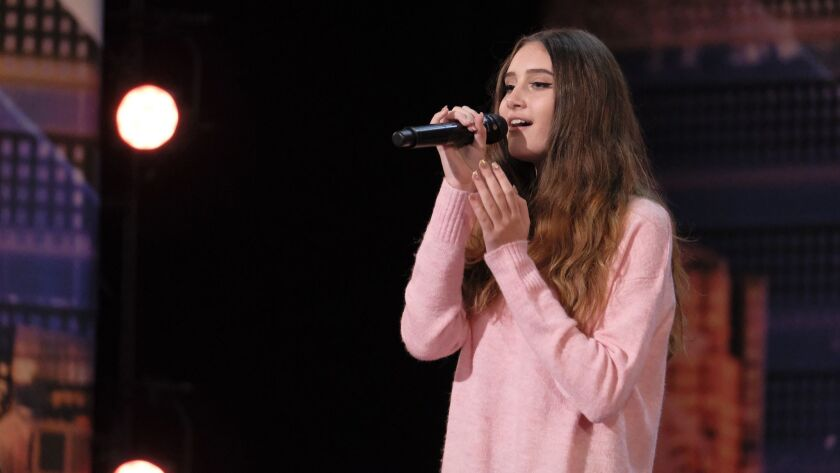 """Makayla Phillips is pictured during her audition for season 13 of America's Got Talent. Judge Heidi Klum's reaction to Phillips' performance resulted in a """"golden buzzer"""" breeze through to the live shows, which air on NBC beginning Tuesday."""