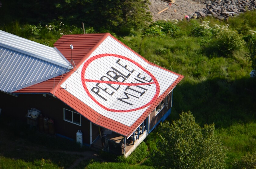 Ban Pebble Mine symbol adorns rooftop in Pedro Bay, Alaska
