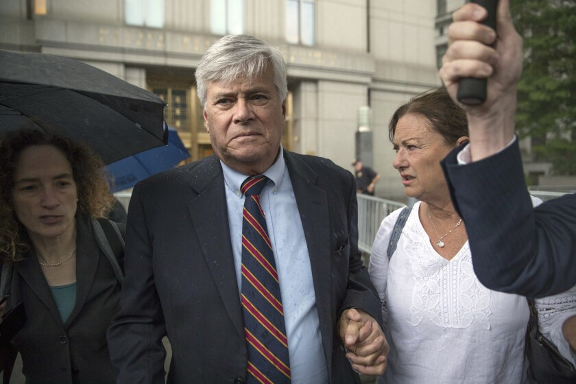 Dean Skelos, center, and his wife Gail, right, leave federal court, Tuesday, July 17, 2018, in New York.