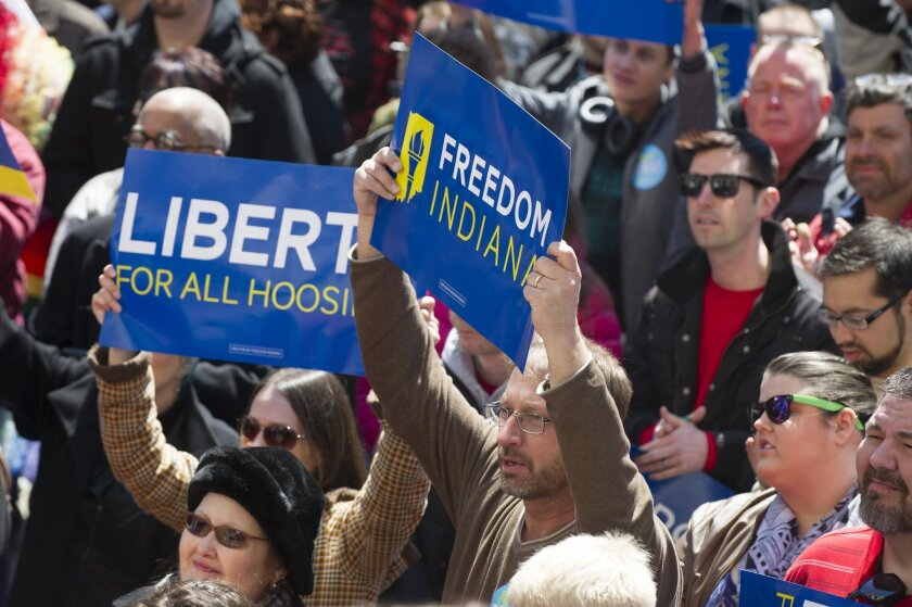 Thousands of opponents of Indiana Senate Bill 101, the Religious Freedom Restoration Act, protest outside the Indiana State House on Saturday.