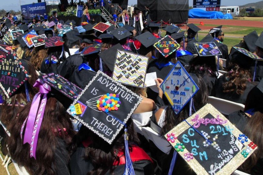 Students' wore decorated mortar boards at a California State University San Marcos graduation