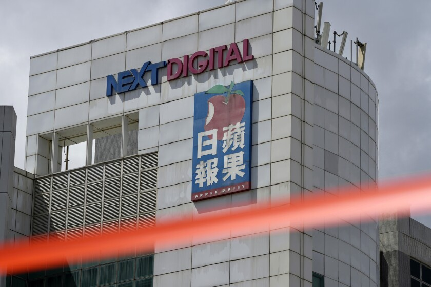 Apple Daily headquarters in Hong Kong behind police cordon