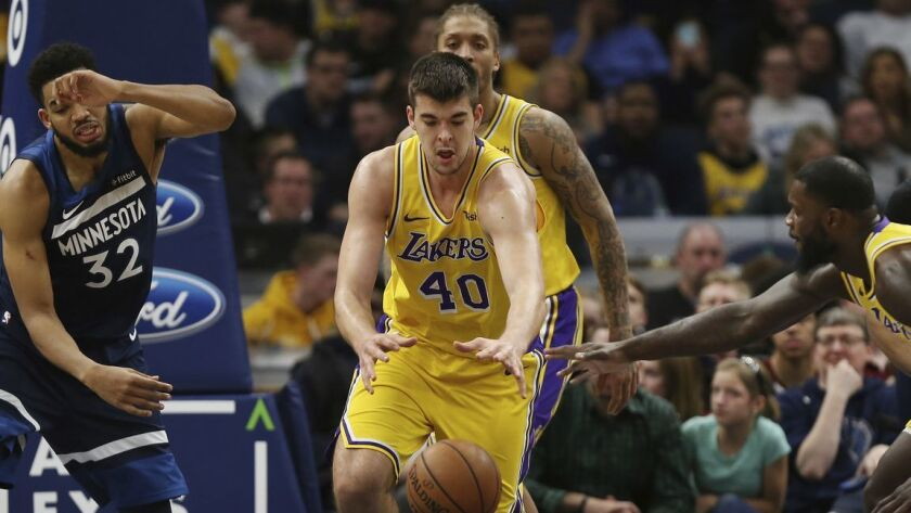Lakers center Ivica Zubac, trying to chase down a loose ball against Timberwolves center Karl-Anthony Towns, started at forward on Sunday in an unusual lineup that also featured JaVale McGee.