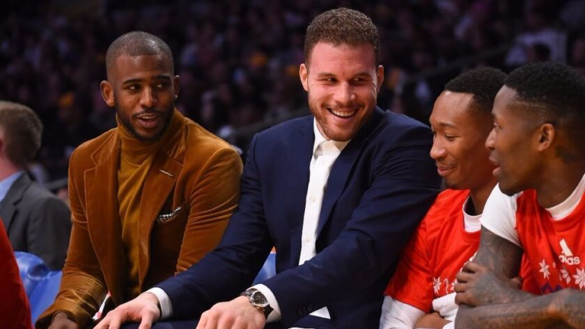 Clippers Chris Paul and Blake Griffin talk with Wesley Johnson and Jamal Crawford during a game against the Lakers on Dec. 25.