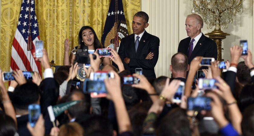 President Obama and Vice President Biden listen as Diana Calderon, a student who has benefited from the Deferred Action for Childhood Arrivals (DACA) program, speaks at a reception in the White House on Oct. 15.