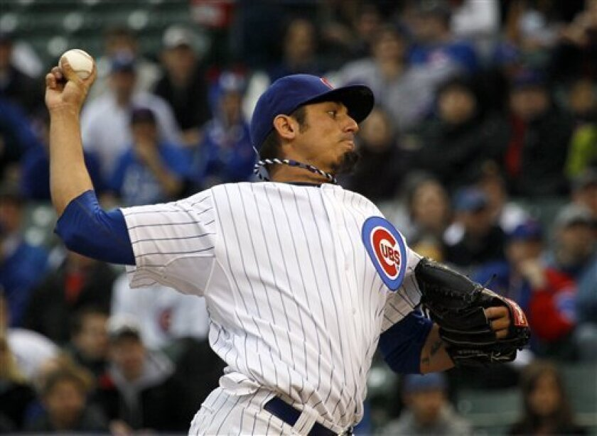 Chicago Cubs starting pitcher Matt Garza delivers during the first inning of a baseball game against the Pittsburgh Pirates, Sunday, April 3, 2011, in Chicago. (AP Photo/Charles Rex Arbogast)