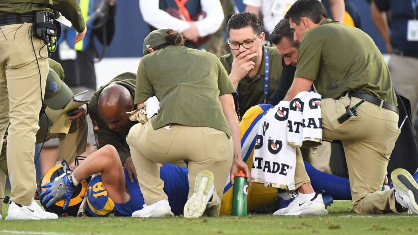 LOS ANGELES, CALIFORNIA NOVEMBER 11, 2018-Rams receiver Cooper Kupp holds his head after injuring hi