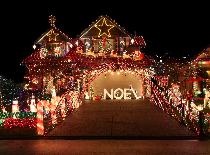 A house with many Christmas decorations and lights