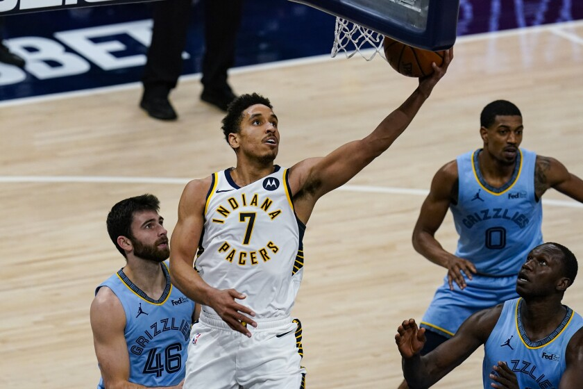 Indiana Pacers guard Malcolm Brogdon (7) shoots in front of Memphis Grizzlies guard John Konchar (46) during the second half of an NBA basketball game in Indianapolis, Tuesday, Feb. 2, 2021. (AP Photo/Michael Conroy)