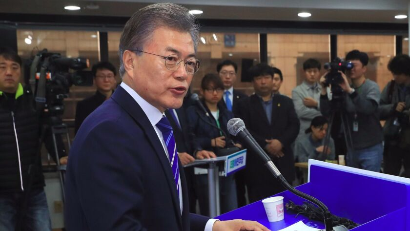 South Korean presidential candidate Moon Jae-in speaks during a news conference in Seoul on March 12.