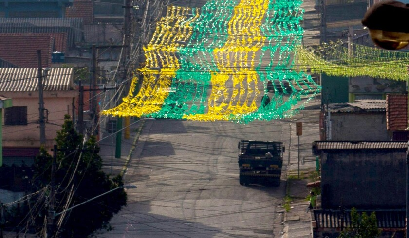 A decorative flag in the colors of the Brazilian team stretches over a street near Corinthians Arena, site of the opening FIFA World Cup game on Thursday.