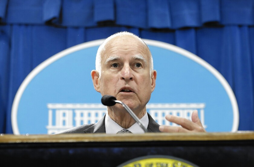 California Gov. Jerry Brown discusses his revised state budget plan at a news conference at the Capitol in Sacramento.