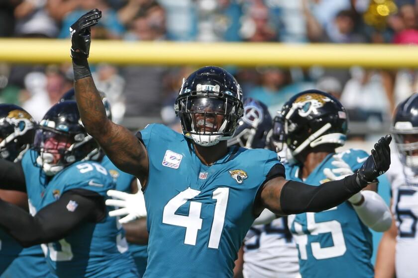 Jacksonville Jaguars outside linebacker Josh Allen (41) celebrates after sacking Tennessee Titans quarterback Ryan Tannehill during the second half of an NFL football game, Sunday, Oct. 10, 2021, in Jacksonville, Fla. (AP Photo/Stephen B. Morton)