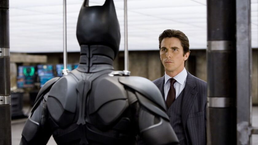 "Christian Bale stars as Bruce Wayne in ""The Dark Knight."""