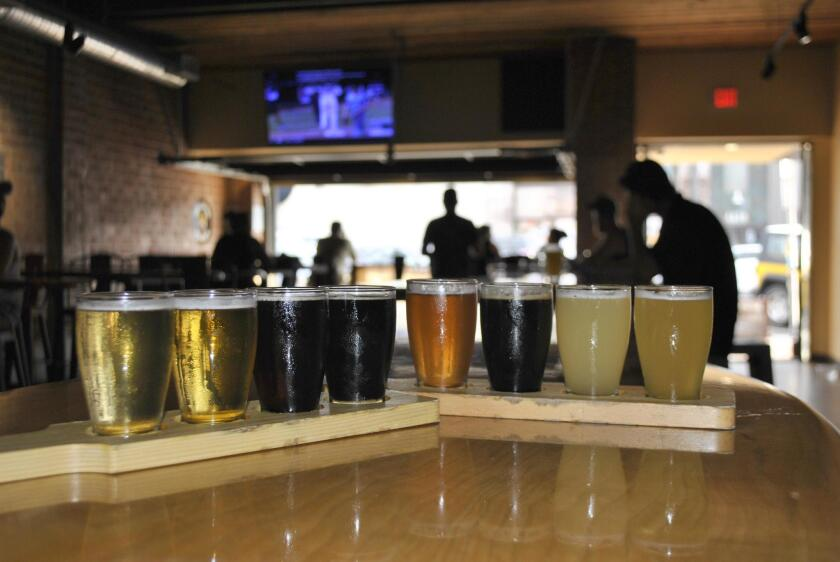 A couple of flights that showcase the variety of beers offered at Belching Beaver Brewery Ocean Beach.