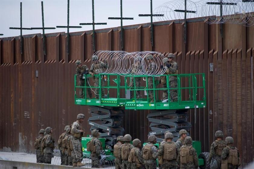 United States military install concertina wire on top of the US-Mexico border wall near the Otay Mesa Port of Entry border crossing, in San Diego, California, USA, 19 November 2018. The US military has been assisting Customs and Border Protection to install concertina wire and other measures to secure the border crossing and the US-Mexico border wall. Asylum seekers frequently cross the US-Mexico border or enter the ports of entry to present themselves to US immigration to seek asylum. EPA-EFE/DAVID MAUNG