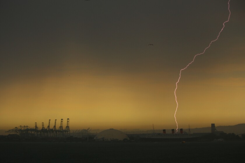 Lightning strike over the Queen Mary in Long Beach on Tuesday. Wind, showers and lightning rolled through the area late in the afternoon.