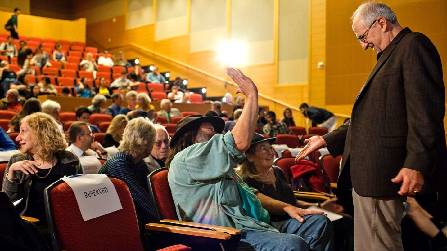 """Free Speech Movement veterans Jack Weinberg, right, Anita Medal and Jack Radey share a moment before the keynote address by Robby Cohen for the 50th anniversary of the Free Speech Movement at Stanley Hall at UC Berkeley on Tuesday. Weinberg sparked a spontaneous, 32-hour sit-in by UC Berkeley students when he was arrested on Oct. 1, 1964, for representing the Congress of Racial Equality at a table set up on campus. """"It never felt courageous,"""" Medal said of their protest efforts. """"Your passion overrides any sense of caution."""""""