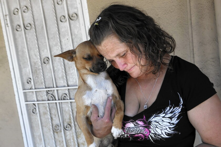 Kathleen Anderson outside the abandoned home she and her husband, Johnny Ray Anderson, were living in when he was fatally shot by L.A. County sheriff's deputies in Hawaiian Gardens on Sunday.