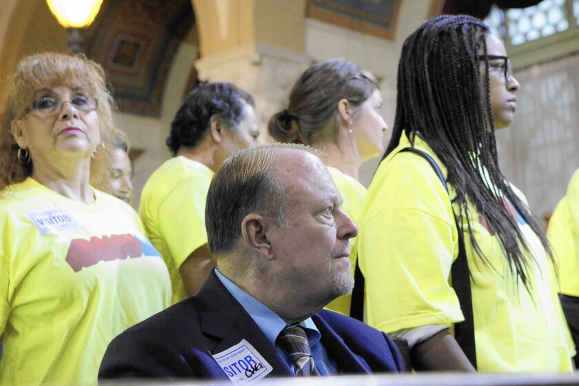 Jim Dunn, owner of the Airtel Plaza Hotel, opposes Mayor Eric Garcetti's propsed minimum wage hike for hotel workers. He and supporters of the pay raise attend a City Council session Sept. 24.