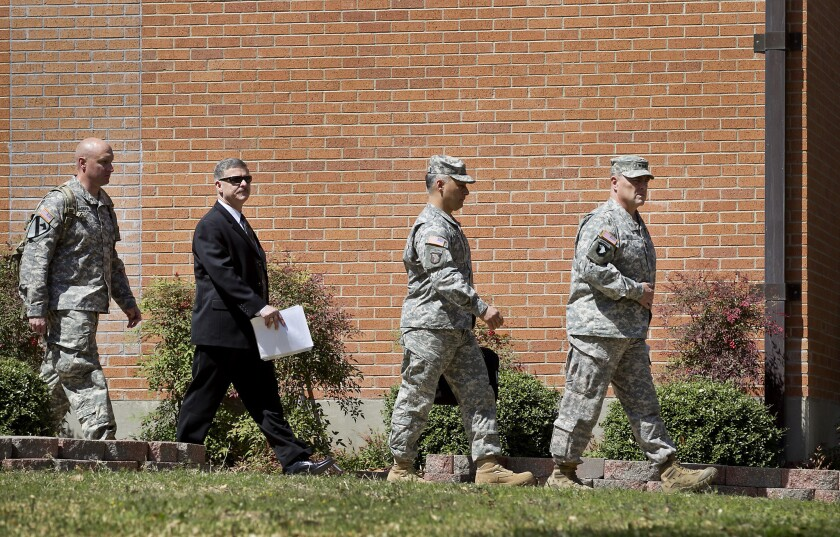 Lt. Gen. Mark Milley, commanding officer at Ft. Hood, leads other Army officials to a news conference Friday.