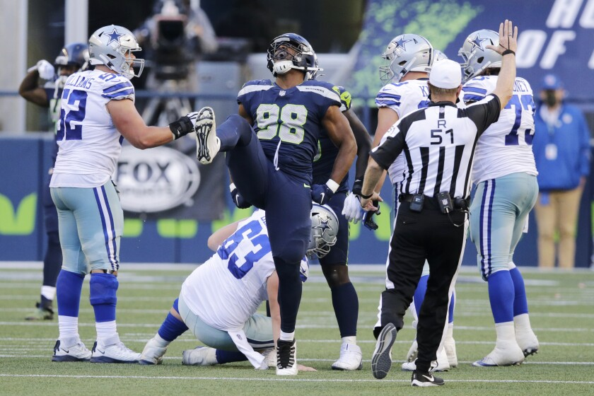 Seattle Seahawks defensive end Alton Robinson (98) celebrates a play during the second half of an NFL football game against the Dallas Cowboys, Sunday, Sept. 27, 2020, in Seattle. The Seahawks won 38-31. (AP Photo/John Froschauer)