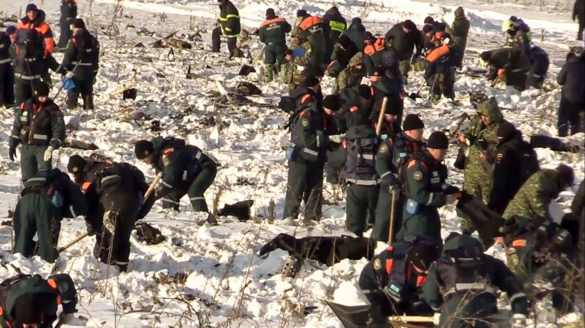 In this photo provided by the Russian Emergency Situations Ministry, Emergency teams work at the sce