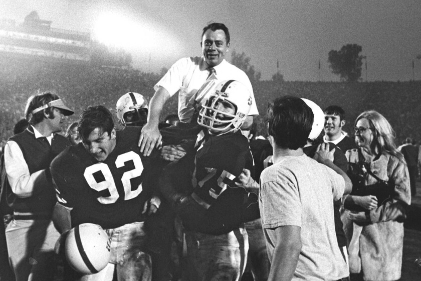 Coach John Ralston carried by Stanford football players