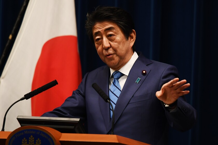 Japanese Prime Minister Shinzo Abe speaks to reporters during a news conference in Tokyo.