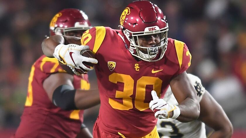 LOS ANGELES, CALIFORNIA NOVEMBER 24, 2018-USC running back Markese Stepp tries to break a tackle by