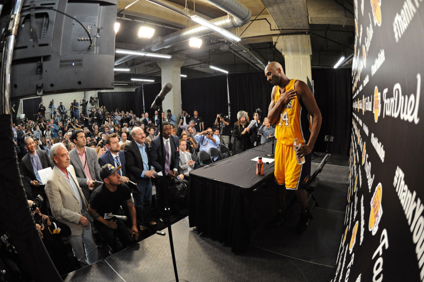 Kobe Bryant speaks to reporters after his final NBA game April 13, 2016