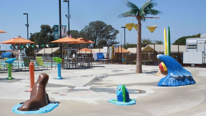 The adjacent Ann Woolley Aquatic Center features a splash pad for youth water play.