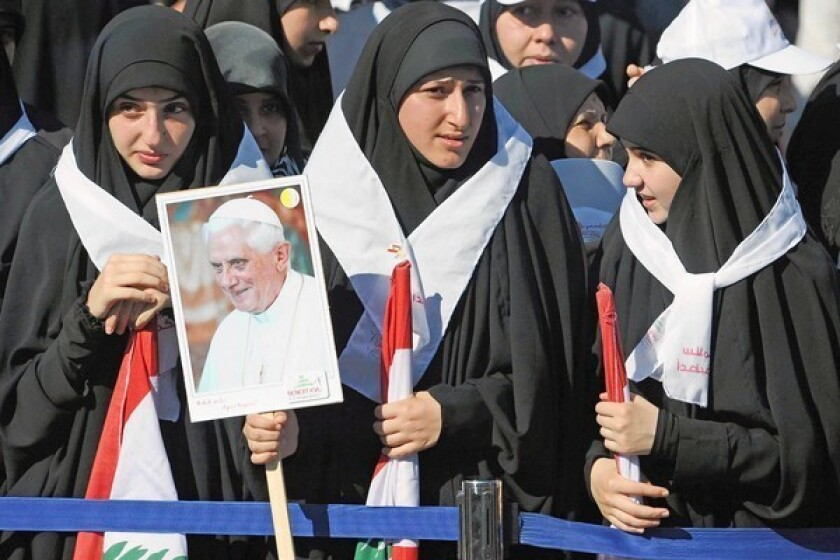 Women wait for the arrival of Pope Benedict XVI at the presidential palace in Baabda, near Beirut.