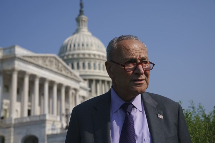 Senate Majority Leader Chuck Schumer, D-N.Y., arrives to meet with Speaker of the House Nancy Pelosi, D-Calif., before an event to promote investments in clean jobs, at the Capitol in Washington, Wednesday, July 28, 2021. (AP Photo/J. Scott Applewhite)