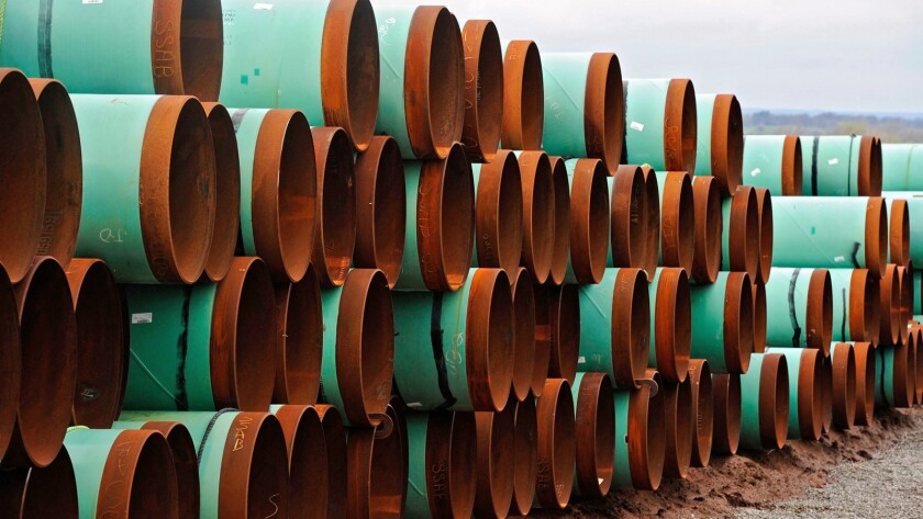 Piping for the Keystone XL line sits stacked at the TransCanada Pipe Yard near Cushing, Okla.