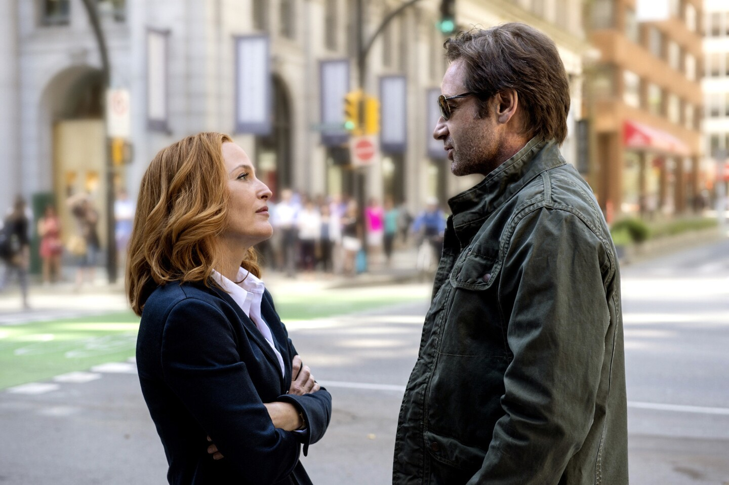 """Gillian Anderson as Dana Scully and David Duchovny as Fox Mulder in """"The X-Files."""""""