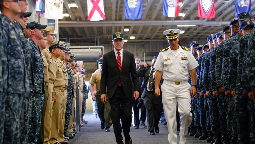 Navy Secretary Ray Mabus, left, and Cpt. Joe Olson aboard the amphib America on Oct. 19, 2016. Mabus has said the pivot to the Pacific makes San Diego the future of America's maritime might.