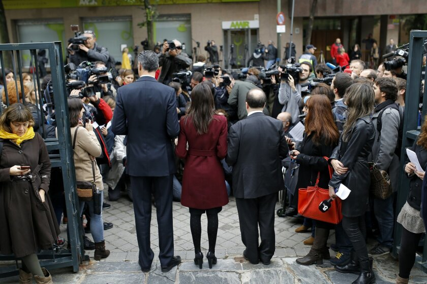 Catalan branches of Spain's ruling conservative Popular Party, Xavier Albiol, Citizens party, Ines Arrimadas, and Socialist party, Miquel Iceta, backs to camera from left, pose for the media after filling complaints at Spain's Constitutional Court in Madrid, Wednesday, Nov. 4, 2015. Three anti-inde