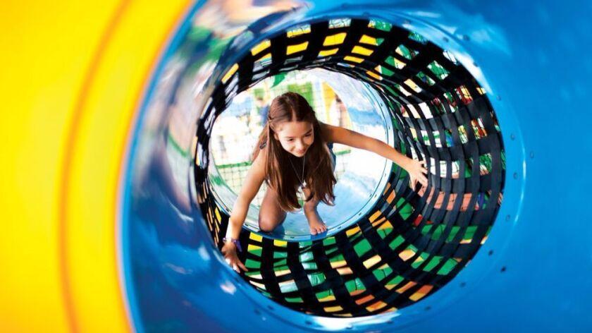 Girl climbing in play area