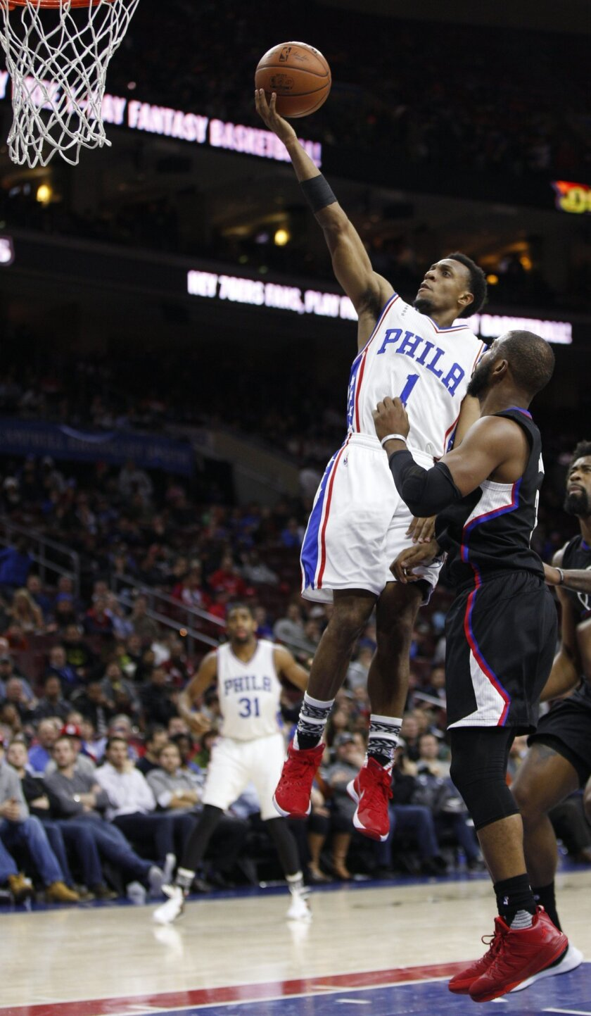 Philadelphia 76ers' Ish Smith (1) goes up for the shot with Los Angeles Clippers' Chris Paul (3) defending during overtime of an NBA basketball game, Monday, Feb. 8, 2016, in Philadelphia. The Clippers won 98-92 in overtime. (AP Photo/Chris Szagola)