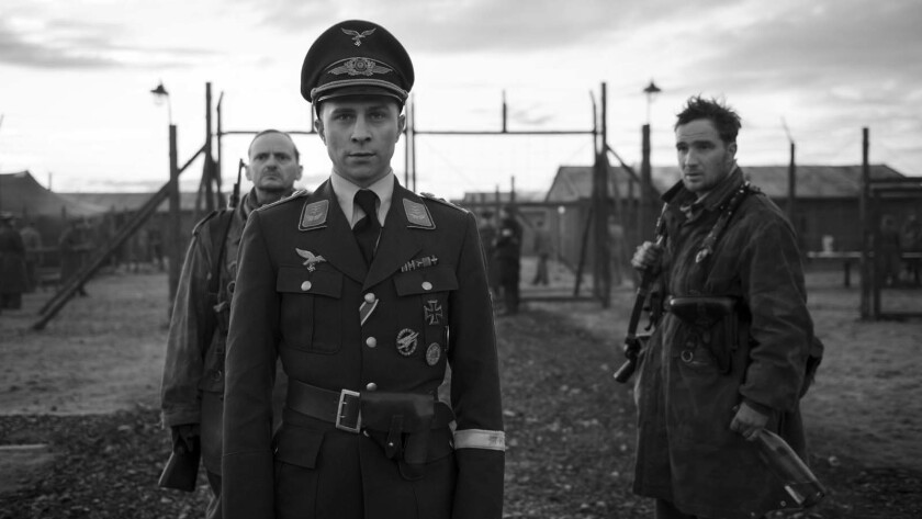 """Milan Peschel, from left, Max Hubacher and Frederick Lau in the movie """"The Captain."""""""