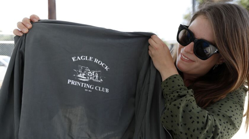LOS ANGELES, CA MAY 4, 2019: Alexandra Bolinder-Gibsand, 29, of Los Angeles holds up a jacket duri
