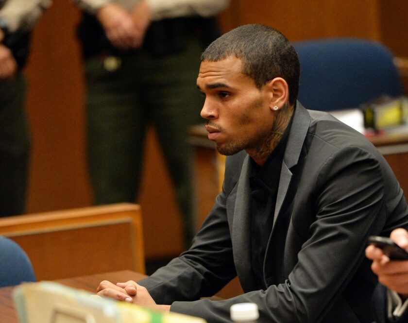 Chris Brown appears at a hearing in Los Angeles County Superior Court. Prosecutors said the decision to drop certain charges in an alleged hit-and-run won't influence their pursuit of probation violation against him.