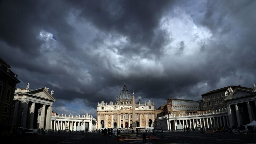 Clouds hang over St. Peter's Basilica, at the Vatican, Thursday, June 29, 2017.
