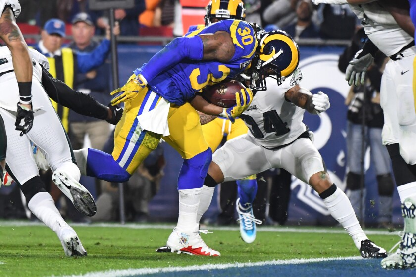 LOS ANGELES, CALIFORNIA DECEMBER 16, 2018-Rams running back Todd Gurley scores a touchdown against t